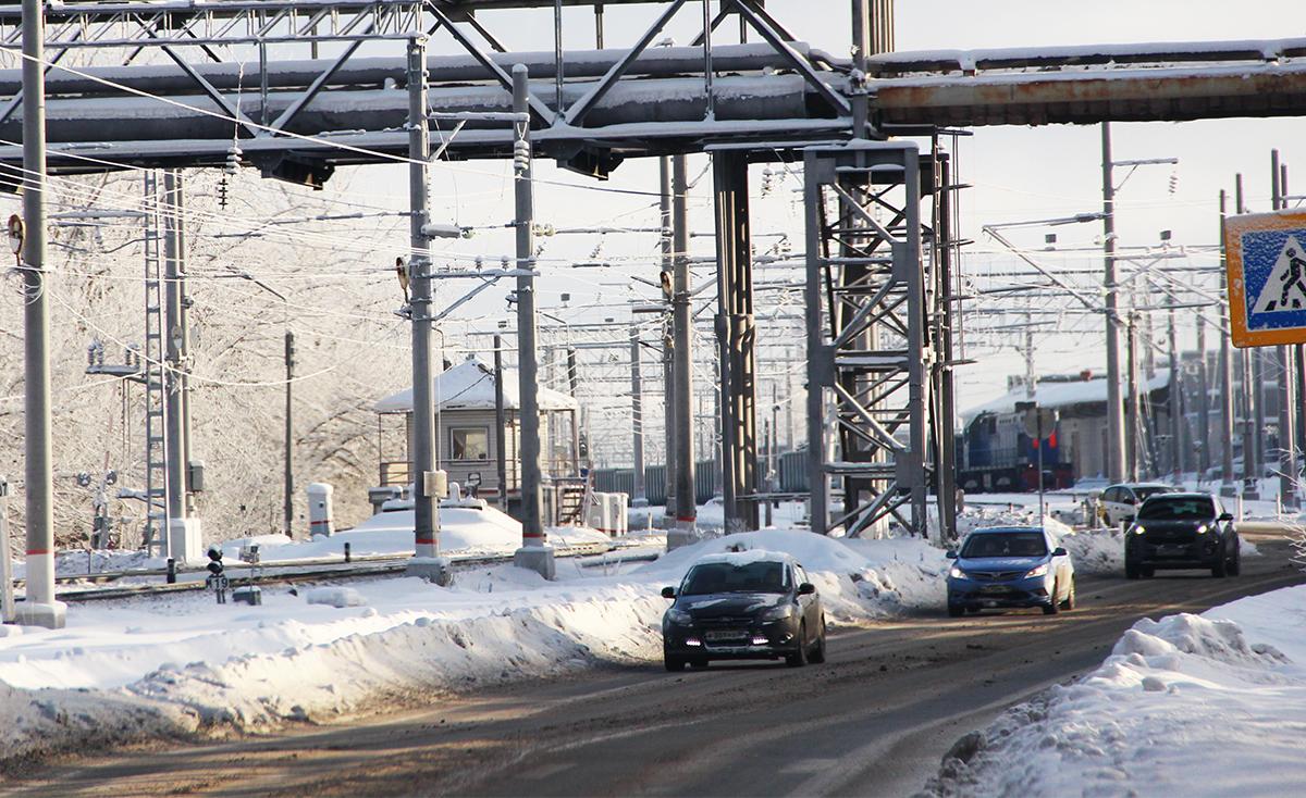 Машины и железнодорожный переезд